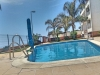 Seconds From The Sea With Pool, A fully Furnished 2 Bed Apartment With Garage & Views.