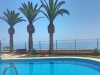 Seconds From The Sea With Pool, A fully FurniSUPERB 2 Bed Apartment With Garage & Views.
